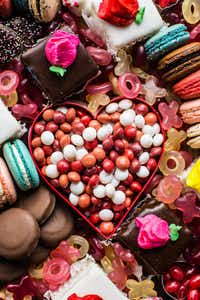 Petit fours, macarons, jelly beans and more comprise a Valentine's Day dessert board(Rebecca White/Special Contributor)