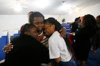 <p>Beverly Oderbert (in stripes), mother of Mark Oderbert II, embraced Alexis Jackson (left) and Davine McCrary during a memorial service at Paradise Missionary Baptist Church on Dec. 26, 2018.</p>(Nathan Hunsinger/Staff Photographer)