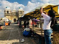 Workers at the open-air market in San Martin Jilotepeque pack up to leave. The church is undergoing renovation with help from remittances sent from abroad, including families in Texas.(Alfredo Corchado/Staff)