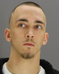 Austin Reed, 26, shown in a Dallas County Jail booking photo(Dallas County Jail)