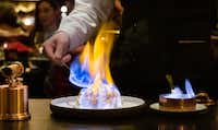 Dinner at the NoMad restaurant is as much a show as a meal, concluding with baked Alaska finished tableside. (Michael Hiller/Special Contributor)