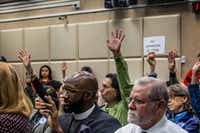 "<p><span style=""font-size: 1em; background-color: transparent;"">People raised their hands to speak as the Dallas Police Department presented recommendations for the Citizens Police Review Board to the Dallas City Council on Monday. Members of the Dallas-based political group Citizens Matter, which strongly opposed the removal of the city's Confederate monuments, showed up at Monday's meetings with signs that read ""No expansion of CPRB.""</span></p>(Carly Geraci/Special Contributor)"