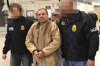 """This file handout photo released by the Mexican Interior Ministry shows Joaquin Guzman Loera aka """"El Chapo"""" Guzman escorted in Ciudad Juarez by the Mexican police as he is extradited to the United States in 2017.(Agence France-Presse)"""