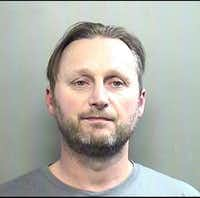 Michael Queen, 44, was arrested Jan. 30 in Arlington after police say they found him digging through the trash to steal sensitive documents.(Arlington Police Department)