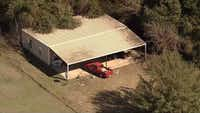 <p>An aerial photo shows the home where officials say Wise County sheriff's deputies found four malnourished children under the age of 5, including two locked in a dog kennel. Their mother and a man identified as the father of one of the children were arrested and charged with four counts of endangering a child, Sheriff Lane Akin said.</p>(NBC5/KXAS-TV)