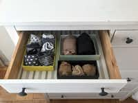 Socks and tights are arranged in a drawer in small boxes at a home in Washington, D.C., as recommended by Japanese tidying expert Marie Kondo.(SARA KAMOUNI/AFP/Getty Images)