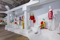 """Product packaging is a theme in some of the fashions on display at Jeremy Scott, Installation View of """"VIVA AVANT GARDE: A Jeremy Scott Retrospective"""" at Dallas Contemporary(Kevin Todora/Dallas Contemporary)"""