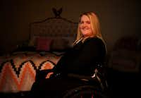 Sarah Milburn was paralyzed in an accident that occur following the driver of the Uber she was riding in running a red light. Milburn was photographed in her Dallas home Tuesday December 20, 2016. (Andy Jacobsohn/The Dallas Morning News)(Andy Jacobsohn/Staff Photographer)