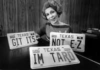 Bettie Capp, a license clerk in the office of the Tarrant County Tax Assessor-Collector, holds a personalized license plate.(1979 File Photo/Staff)