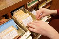 Catherine Gilman thumbs through the seed library, which is housed in old card catalog drawers.(2017 File Photo)