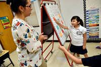 First-grade teacher Annette Hinojosa worked with student Zoe Avalos during a class activity on the first day of school at Arturo Salazar Elementary school in Dallas on Aug. 28, 2017.(Ben Torres/Special Contributor)