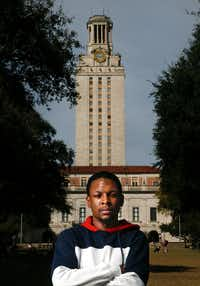 "Joshua Ellis, African and African Diaspora studies senior, poses for a portrait with the UT tower in Austin on Feb. 15, 2019. Ellis said he doesn't sing the school's spirit song, ""The Eyes of Texas,"" because of its racist history.(Daniel Carde/Staff Photographer)"