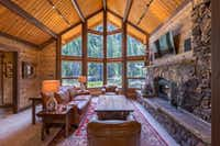 Guests at the Triple Creek Ranch in Montana stay in 25 log cabins, combining modern comforts with Western style. (Pam Voth/Triple Creek Ranch)