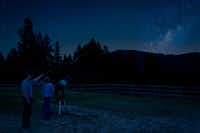 Guests at the Triple Creek Ranch find a secluded spot for stargazing, with the center of the Milky Way rising above the surrounding mountains. (Triple Creek Ranch)