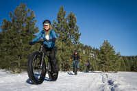 Fat tire biking is one way to burn off the calories on the snowy trails around the Triple Creek Ranch. (Jessica Fay Photography/Triple Creek Ranch)