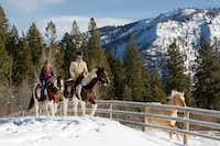 Hitting the trail on horseback is a great way to see the winter scenery at Montana's Triple Creek Ranch. (Pam Voth/Triple Creek Ranch)