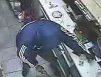 Lewisville released this still image from store surveillance video of one of two suspects after a clerk was shot and killed during a robbery at a Valero convenience store on Friday.(Lewisville Police Department)