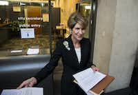 Former Dallas Mayor Laura Miller leaves the city secretary's office after filing the required petition signatures to secure a place on the ballot for Dallas City Council District 13 on Friday at Dallas City Hall.(Ashley Landis/Staff Photographer)