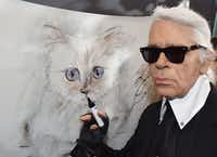 "<p><span style=""font-size: 1em; background-color: transparent;"">In this file photo taken on Feb. 3, 2015, German fashion designer, artist and photographer Karl Lagerfeld poses next to a painting of his cat ""Choupette"" during the inauguration of the show ""Corsa Karl and Choupette"" at the Palazzo Italia in Berlin. German fashion designer Karl Lagerfeld has died at the age of 85.</span></p>(Jens Kalaene/Agence France-Presse/Getty Images)"