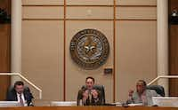 Dallas County Judge Clay Jenkins (middle) speaks alongside Dallas County Commissioners J.J. Koch (left) and John Wiley Price during a Dallas County Commissioners Court meeting on Tuesday.(Rose Baca/Staff Photographer)