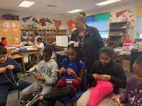 <p>Charlotte Geisler teaches some of her fifth-grade students at Wilmer-Hutchins Elementary School how to crochet. Once a month, Geisler collects the items they create and donates them to local homeless shelters.</p>(Cassidy Najarian)