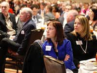 Jessica Trudeau, center, and Paige Conley, right, both with the Momentous Institute, listen to  Dallas Mayor Mike Rawlings give his annual State of the City address at a Dallas Regional Chamber luncheon Tuesday, December 5, 2017.(Ron Baselice/Staff Photographer)