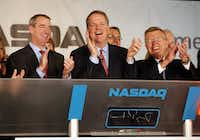 When American Airlines CEO Doug Parker (center) rang the opening bell for Nasdaq, celebrating the merger of American Airlines and US Airways in 2013, he was flanked by former CEOs Tom Horton on the left and Robert Crandall on the right.(File Photo/Staff)