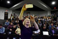 Senator Kirsten Gillibrand holds her phone as she takes a selfie video with students from Paul Quinn College in Dallas, Wednesday,  Feb. 20, 2019.(Ben Torres/Special Contributor)