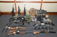This image released by the US Attorney's Office shows weapons seized at the Silver Spring, Md., home of US Coast Guard officer Christopher Paul Hasson. Hasson, who espoused white supremacist views and drafted a target list of Democratic politicians and prominent media figures, was arrested on firearms and drug charges. <br>(HO/AFP/Getty Images)