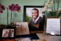 A large photo of Botham Jean with photos and cards displayed on one of the tables in his childhood home in Castries, St. Lucia in September. Botham Jean was shot and killed in his apartment by off-duty Dallas police officer Amber Guyger. She was charged with murder.(Vernon Bryant/Staff Photographer)