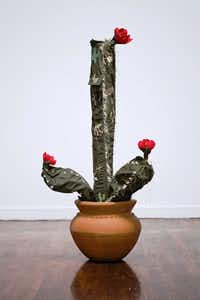 Margarita Cabrera was born in Monterrey, Mexico, and lives and works in El Paso.&nbsp; <i>Space in Between   Saguaro</i>, 2010- 2012    In Collaboration with Maria Lopez; Border Patrol uniform fabric, copper wire, thread and terra cotta pot.(Fredrik Nilsen)