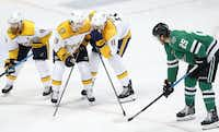 Nashville center Brian Boyle (11) whispers to teammate Calle Jarnkrok out of earshot of Stars right wing Brett Ritchie during a third-period face-off at American Airlines Center in Dallas. (Tom Fox/Staff Photographer)