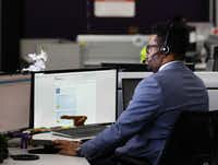 Tramon Arnold is shown in the Teladoc call center in Lewisville in 2016.(David Woo/Staff Photographer)