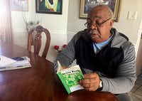Charles Becknell Sr., 77, peruses a copy of the 1954 edition of <i>The Negro Motorist Green Book</i> at his home in Rio Rancho, N.M. The Oscar-nominated interracial road trip movie <i>Green Book</i> has spurred interest in the 20th century guidebook.(Russell Contreras/The Associated Press)