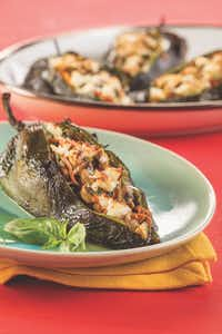 "<p>Veggie Stuffed Poblanos from<i> </i><em style=""font-size: 1em; background-color: transparent;""><a href=""https://www.amazon.com/Comfort-Healthy-Cl%C3%A1sicos-Latinos-Saludable/dp/1580406815"" style=""font-size: 1em; background-color: transparent;""><i>Latin Comfort Foods Made Healthy</i></a>.</em></p>(Chica Worldwide LLC)"