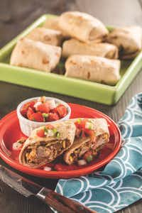 "<p>Carnitas Baked Chimichangas from <em style=""font-size: 1em; background-color: transparent;""><a href=""https://www.amazon.com/Comfort-Healthy-Cl%C3%A1sicos-Latinos-Saludable/dp/1580406815"" style=""font-size: 1em; background-color: transparent;"">Latin Comfort Foods Made Healthy</a>.</em></p>(Chica Worldwide LLC/Chica Worldwide LLC)"