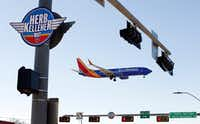 Southwest Airlines Flight 1433 from Oakland passed a Herb Kelleher Way sign as it landed at Dallas Love Field on Jan. 4, 2019.(Tom Fox/Staff Photographer)