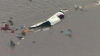 This image taken from video provided by KRIV-TV (FOX 26) shows the wreckage of a cargo plane in Trinity Bay.(AP)