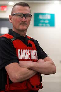 Range Master Ricky Pollan of the Allen Police Department with an Allen city-limits sign at the new Allen police gun range at the Collin College Public Training Center in McKinney.(Brian Elledge/Staff photographer)