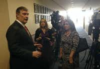 Mayor Mike Rawlingsn (left) met with reporters, including Fox4's Lori Brown (center) and WFAA's Rebecca Lopez (right) after an arrest warrant was issued for council member Kevin Felder, who left Dallas City Hall Monday afternoon. During his departure, the council member was accused of shoving a KXAS-TV (NBC5) cameraman.(Robert Wilonsky/Staff writer)