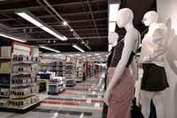 Mannequins in the women's apparel department are across from the home decor aisles inside the small Target store in Dallas' Preston Center Pavilion.(Ben Torres/Special Contributor)