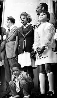 Lucy Patterson (center) at swearing-in ceremonies for Dallas City Council members on the steps of City Hall on May 7, 1973. Kneeling in front of Patterson is her son, Albert, age 3.(File Photo/Staff)