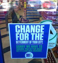 A sign on the door at a 99 Cents Only store at Live Oak and Carroll streets in East Dallas posted an apology to customers in 2015 for having to charge 5¢ for bags due to a new Dallas city ordinance. The ordinance was repealed later that year.(2015 File Photo/Guy Reynolds)