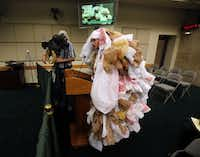 """Edward Hartmann of the Texas Campaign for the Environment came dressed as a """"plastic bag monster"""" to address the Dallas City Council's Quality of Life committee at a November 2013 meeting.(2013 File Photo/Staff)"""