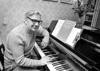 This May 5, 1975, photo shows Dominick Argento at his piano in his Minneapolis home after learning he had been awarded the Pulitzer Prize for music. Argento died Feb. 20, 2019, in Minneapolis. He was 91.(The Associated Press)