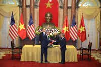 Sabre executive Dave Shirk shakes hands with Vietnam Airlines CEO Duong Tri Thanh during Wednesday's ceremonial signing session in Hanoi as part of President Trump's summit with his counterpart in Vietnam.(Sabre Corp.)