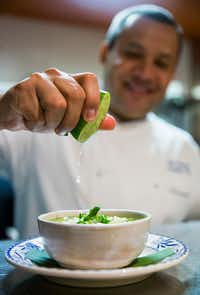 Chef Nico Sanchez squeezes lime juice on top of a bowl of his pozole verde at Mesa Maya.(Ashley Landis/Staff Photographer)