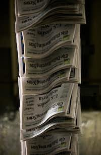Copies of The Dallas Morning News move through the company's printing plant in Plano.(Ashley Landis/Staff Photographer)