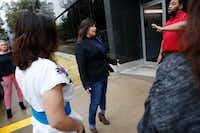 Mandy Watkins of the Beyond Baseball Youth Association is stopped by security on her way to speak to a representative from the Lucious Williams Foundation Wednesday at their office in Dallas.(Rose Baca/Staff Photographer)