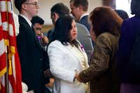 """Maria Rogers (center), mother of Linda """"Michellita"""" Rogers, receives words of encouragement from Rep. Thresa """"Terry"""" Meza (right) Wednesday.(Tom Fox/Staff Photographer)"""